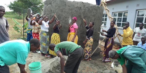 Monze women building water catchment