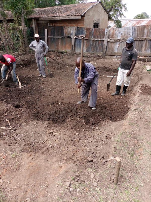 kambiri rainwater catchment tank clearing hoe