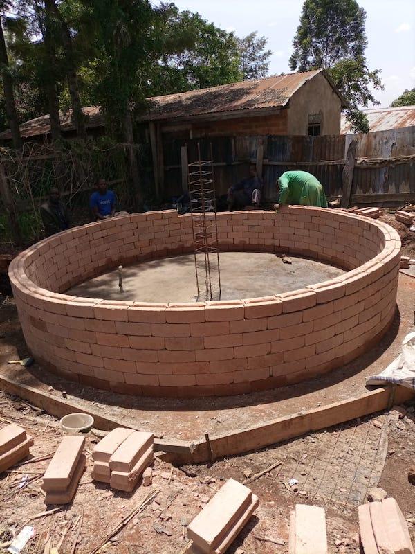 kambiri rainwater catchment tank half wall