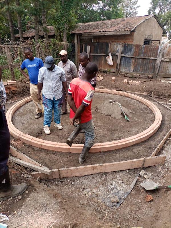 kambiri rainwater catchment tank first brick layer